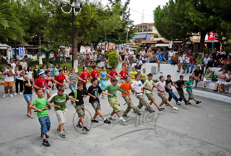 School children rehearsing for public event in Hanioti. (a).