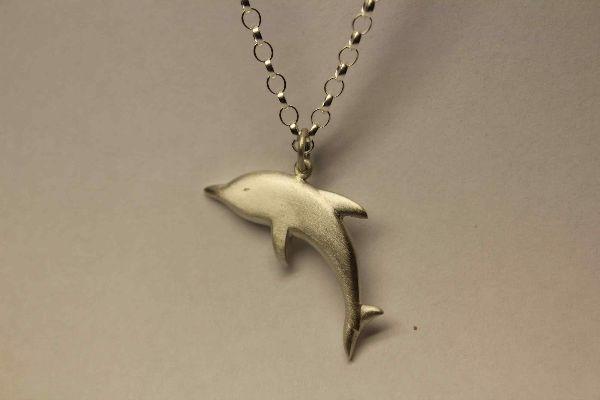 Silver dolphin pendant £104