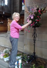 Arranging flowers in the Sanctuary