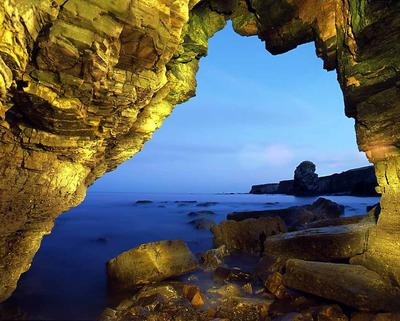 Cave inside Marsden Rock looking towards Pompeys Pillar, South Shields, UK