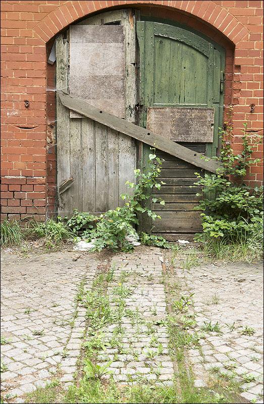 Entrance to old workshops or stores.