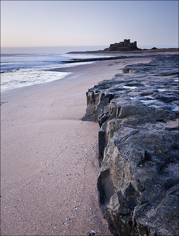 Bamburgh Castle from the rocky shoreline