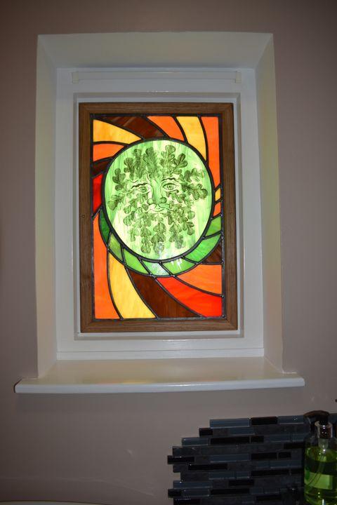 Greenman installed in an internal bathroom window back lit.