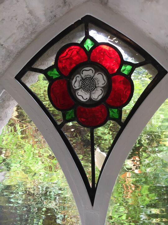Tudor Rose in a newly opened up window