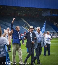 Stan Bowles on the pitch at Loftus Road with Gerry Francis and Don Shanks