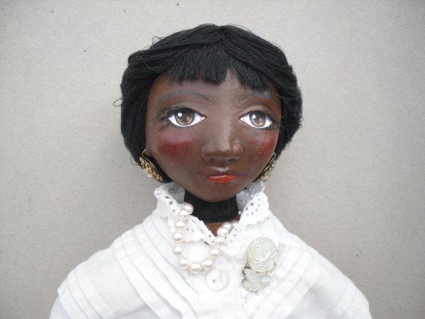 Black doll in 1890s costume (detail)