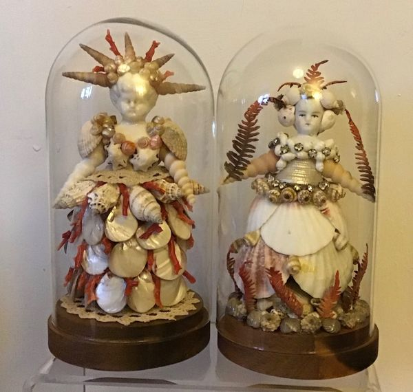 Shell dolls in glass domes