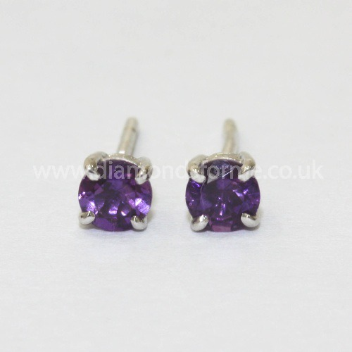 9CT WHITE GOLD FOUR CLAW AMETHYST STUD EARRINGS. (WAS £135.00) NOW £120.00