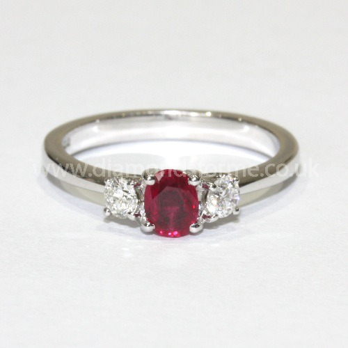 !8CT WHITE GOLD OVAL RUBY 2 BRILLIANT CUT DIAMOND RING 0.14CT.  (WAS £900.00)  NOW £810.00