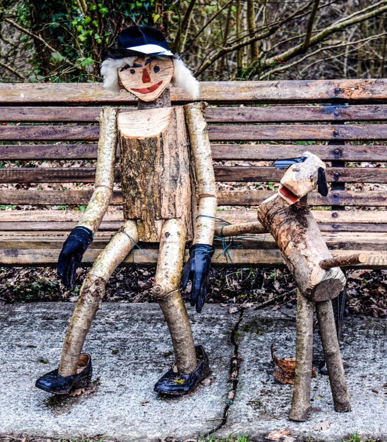 Man and his best friend, made from wood.