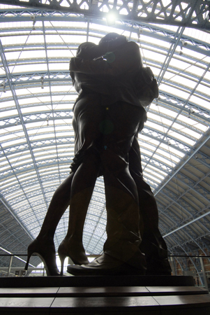 Bronze statue of ` The Meeting Place` at St.Pancras Eurostar Int.Station, London. U.K.