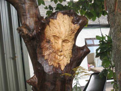 green man on drift tree