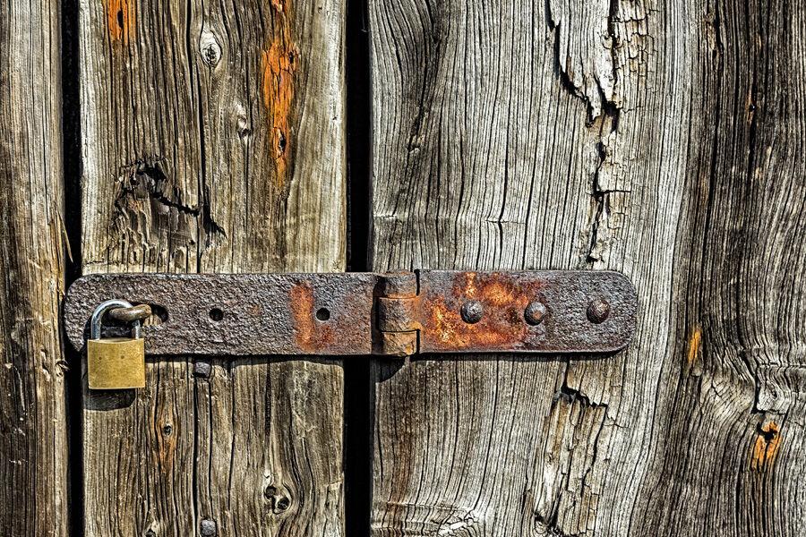 Modern Lock On Old Wood