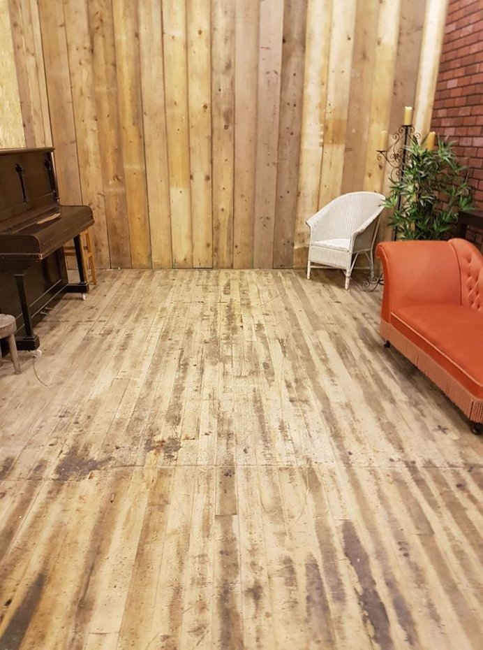 Sanded floor and wooden wall