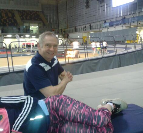 Sports Injury treatment - Chris treating an athlete at a Scottish Athletics indoor event