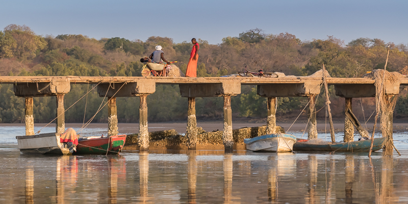 Tendaba pier, Gambia River (note the use of a wheelbarrow as a pushchair)