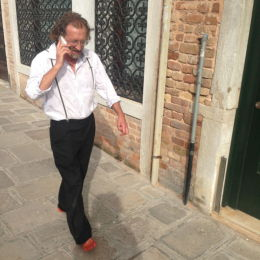 My feet are painted with venetian red to facilitate a connection with the history of the city.