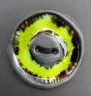 yellow copper brooch