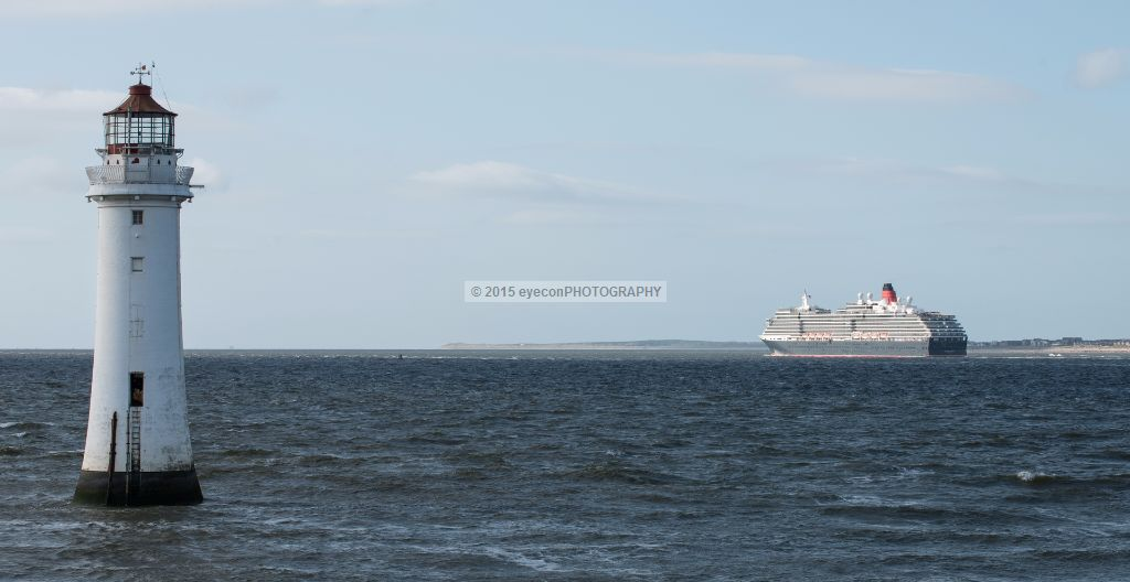 Queen Victoria passing New Brighton lighthouse