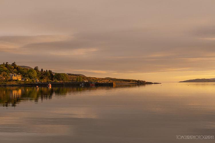 broadford bay harbour at sunrise .