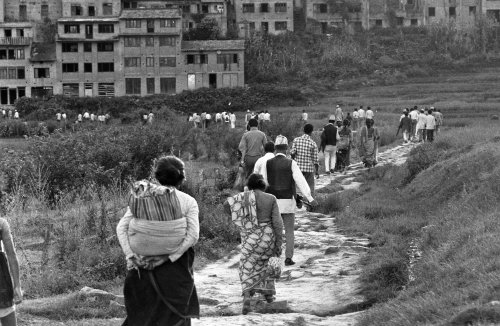 Villagers returning to Kirtipur at end of day