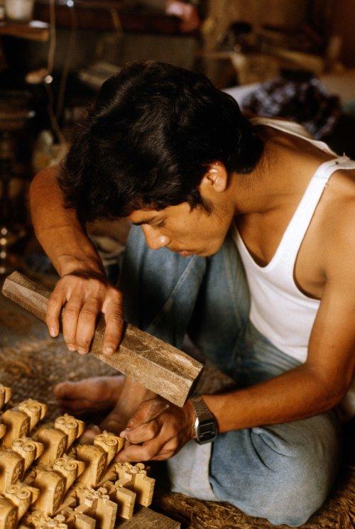 Wood carver Surjeman.