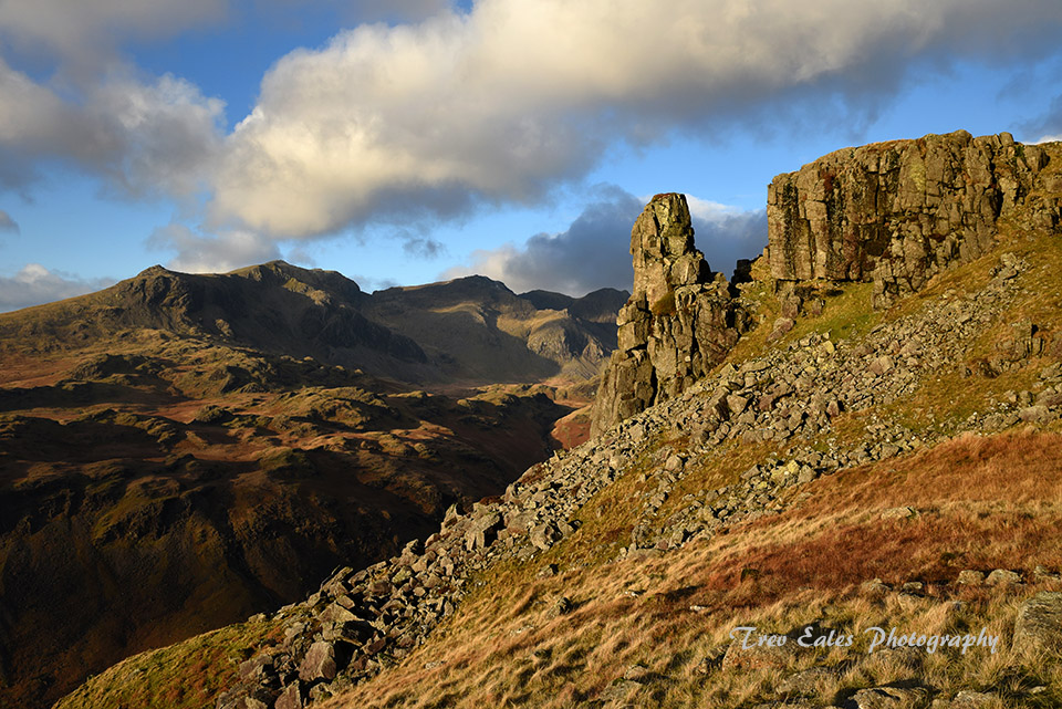Eskdale Needle with the Scafells beyond.