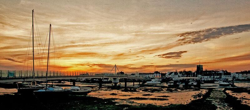 Sunset across the footbridge