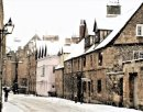 Snow covers the medieval buildings in Merton Street, Oxford