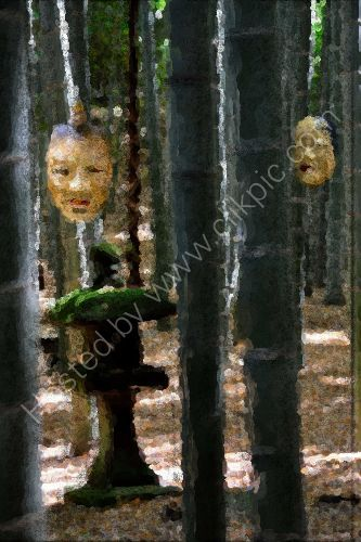 Two masks in a bamboo forest