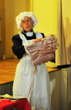 Maid bemused by corset!