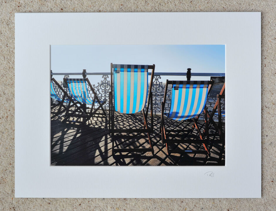 "Deck Chairs on Brighton Pier, A4 print with 16"" x 12"" mount. £20"
