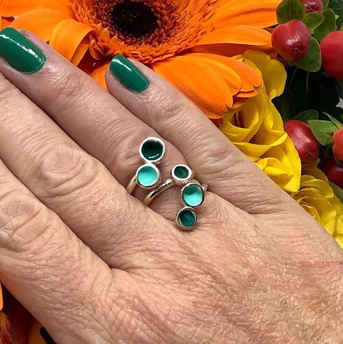 Sterling silver dark green and viridian enamel adjustable ring .