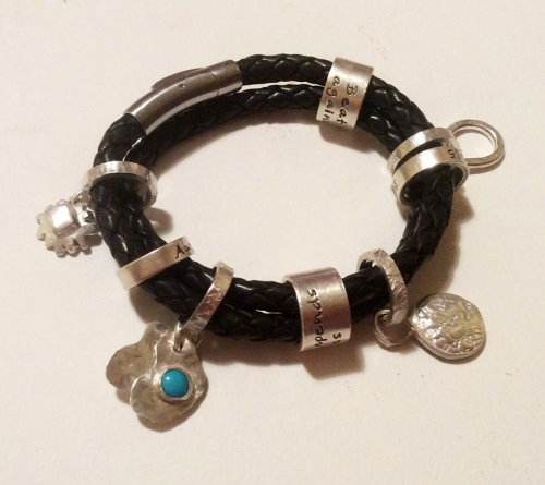 Sterling silver charms added to bracelet