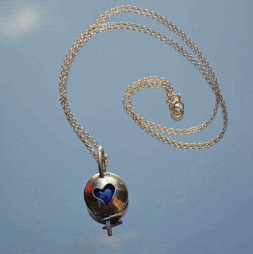 Sterling silver heart marble locket.