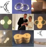 A matched (but different) pair of gold wedding rings, in a hand-made butterfly box