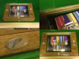 Bespoke display cases for medals.  Each one individually hand-made, with any etching you require, and any additions such as the hall-marked sterling silver cap-badges that you see here.
