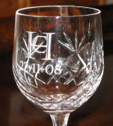 "You design your wedding logo (with a little help from us), we provide any glasses you want with your logo etched on them.  We can also etch an individual message from you to each recipient; for instance ""To John, with thanks for being our best man, with love from Harry and Celia""."