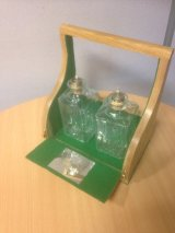 Individually designed and made tantalus (a holder for decanters)