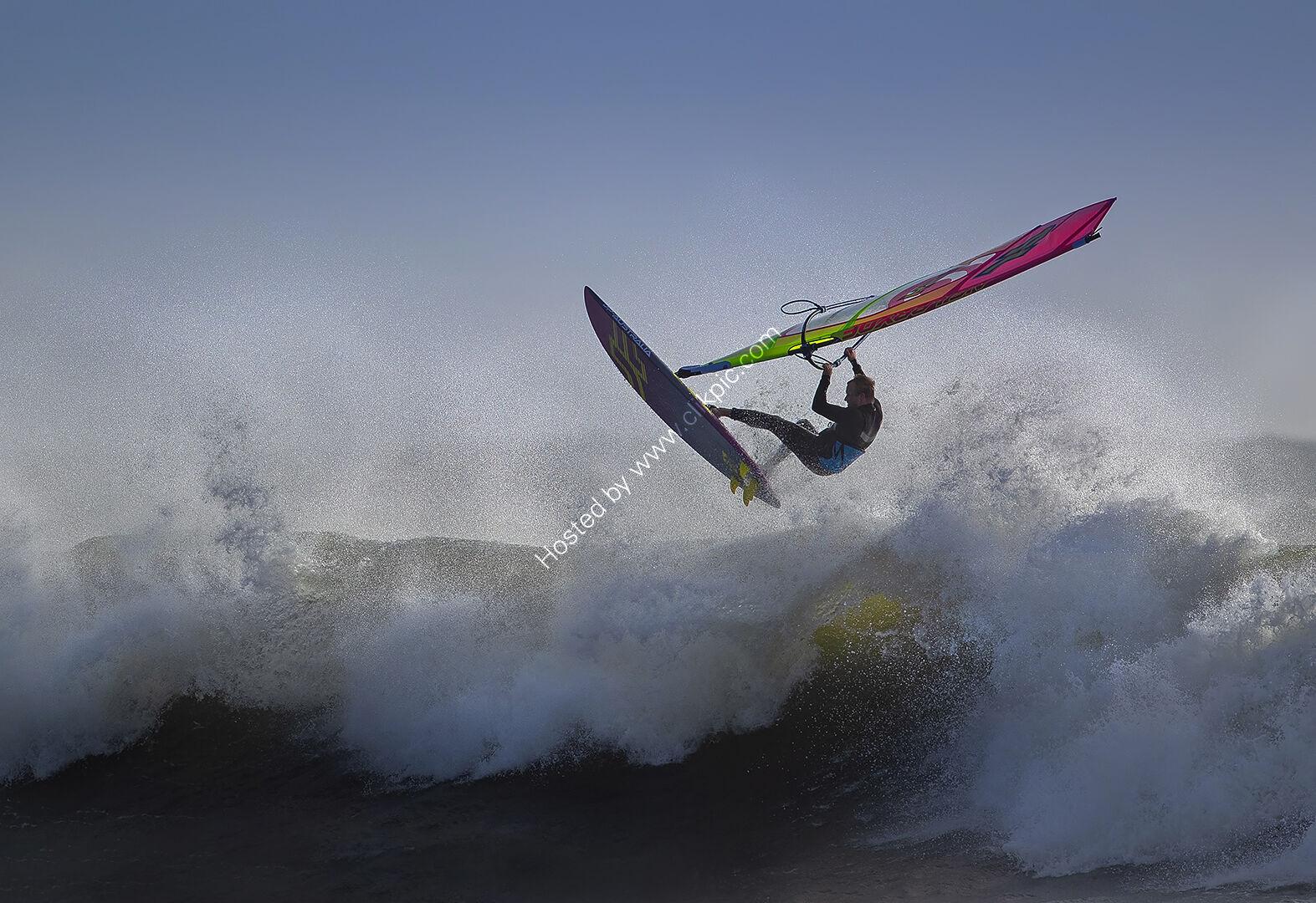 Jumping a backlit wave