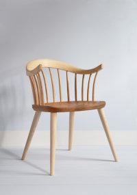 Darwin armchair in ash with an elm seat designed by Dave Green