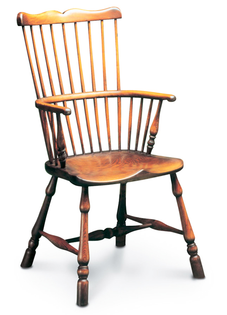 SF28  COMB BACK ARMCHAIR  <br> So-called because the squared-off sticks of its back, joined together with a horizontal rail, resemble a comb.