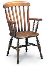 "SF34 FARMHOUSE CARVER  The ""Farmhouse', 'Kitchen', or 'Lath Back' chair is a nineteenth century development of the Windsor chair; the distinctively shaped back laths giving a greater degree of comfort"