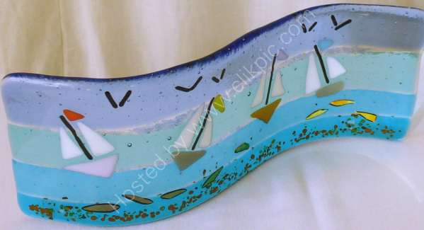 Curved panel showing yachts & dichroic fish
