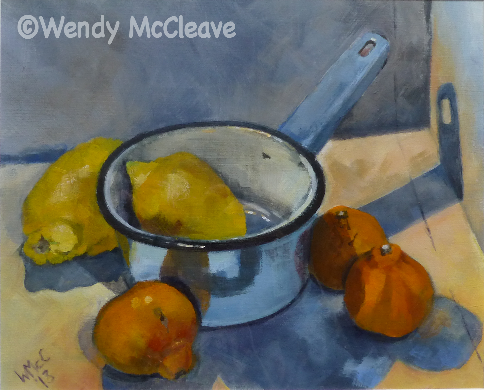 Still life acrylic painting on prepared paper of lemons, satsumas and a blue enamel saucepan in a top lit box.