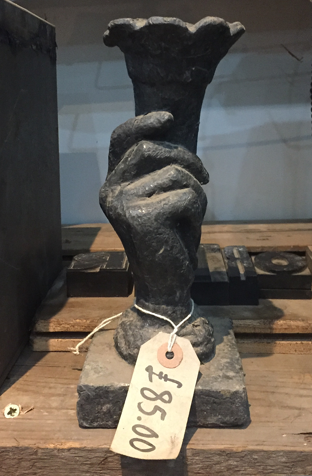 Priced hand sculpture at reclamation centre