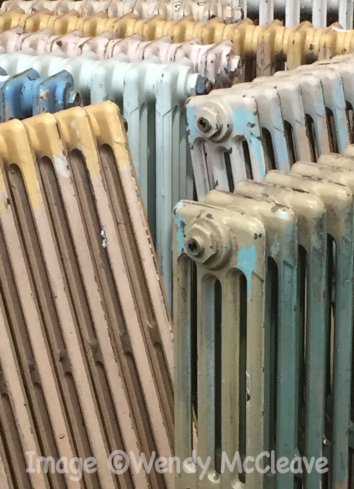 Old painted radiators at a reclamation centre