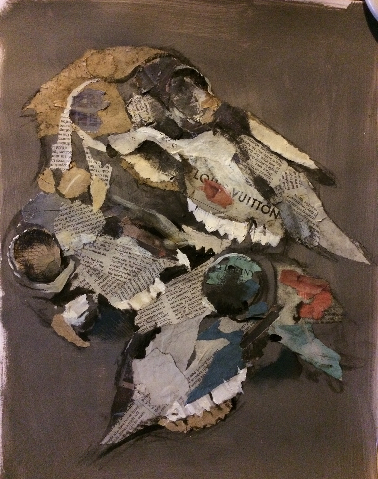 Investigative collage of sheeps' skulls using acrylic paint and newspaper on a dark prepared background