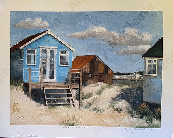 Print of a blue beach hut on Mudeford Sandbank Spit with a view of Christchurch behind