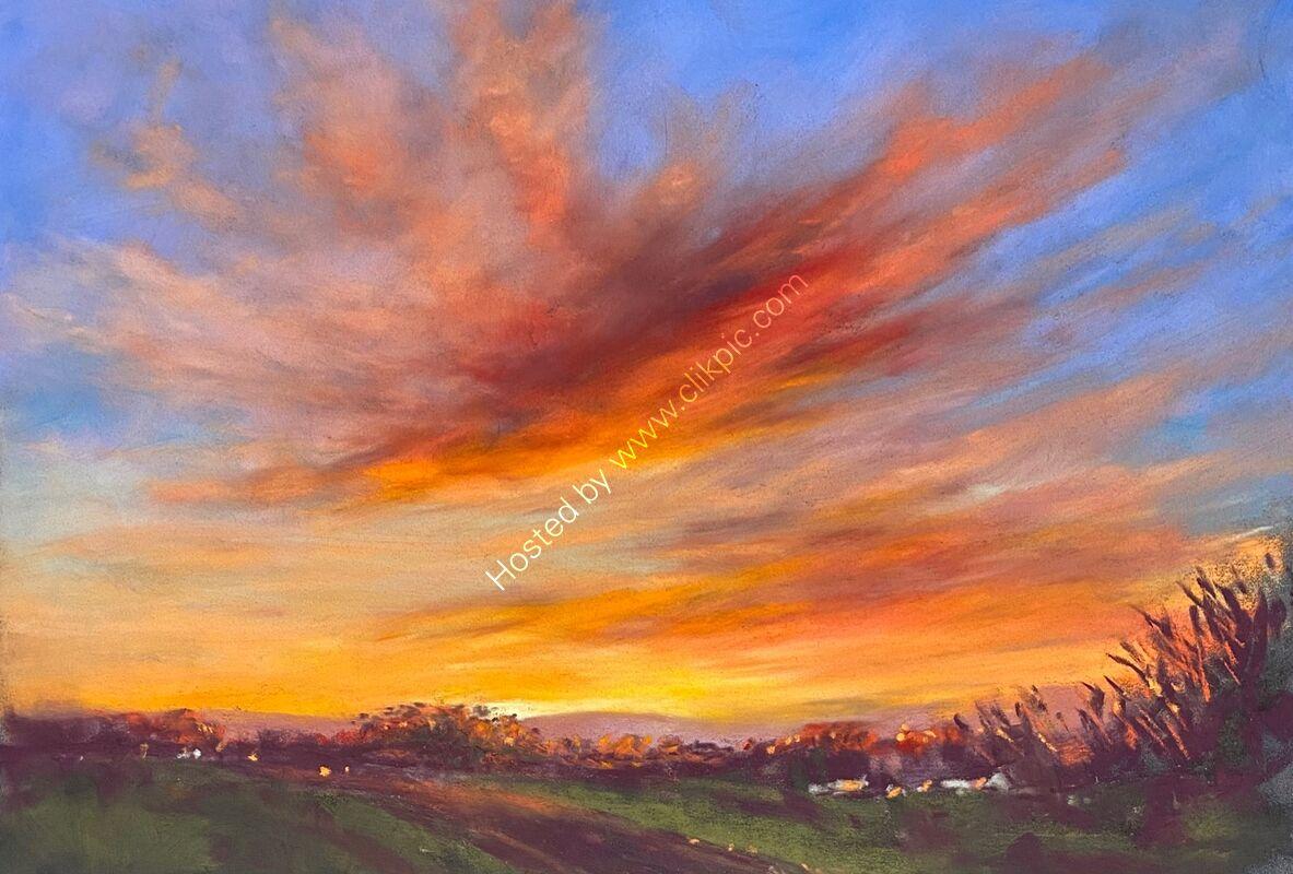 Fiery sunrise over L'Islet